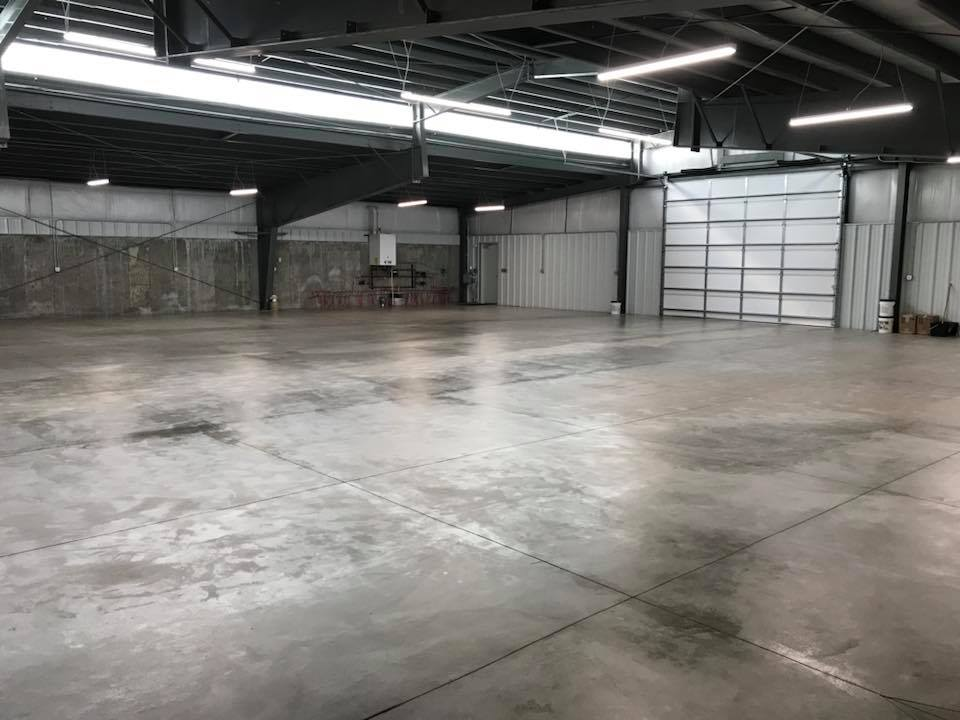 Steel building interior with concrete floor and walls