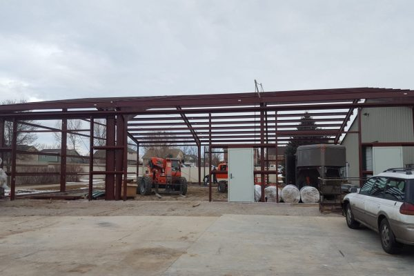 Steel building construction to match existing