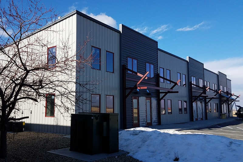 Steel building construction for retail spaces